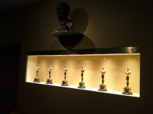 I snapped this pic on the Fox lot last year while attending a premiere in the Zanuck Theater. The bust above the Oscars is of legendary studio chief, Daryl Zanuck.